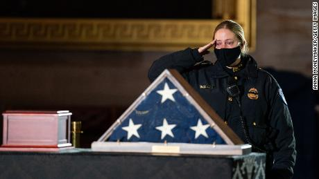 A Capitol Police Officer pays her respects before a ceremony memorializing U.S. Capitol Police Officer Brian D. Sicknick, 42, as he lies in honor in the Rotunda of the Capitol on Wednesday, February 3, 2021