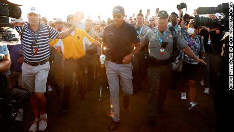 Mickelson walks the 18th fairway before winning the 2021 PGA Championship.
