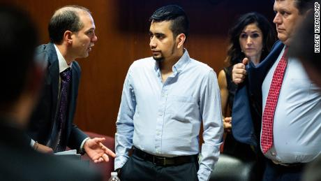 Cristhian Bahena Rivera speaks to a court interpreter during his trial on May 26, 2021.