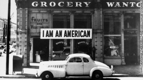 A sign reading: 'I AM AN AMERICAN', on the Wanto Co grocery store in Oakland, California, the day after the attack on Pearl Harbor, 8th December 1941.