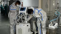 Health workers wearing protective gear place a defunct ventilator machine in the corridor of a hospital amid Covid-19 coronavirus pandemic in Amritsar on May 14, 2021. (Photo by NARINDER NANU / AFP) (Photo by NARINDER NANU/AFP via Getty Images)