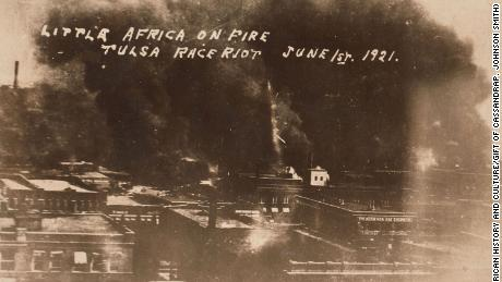 The Greenwood District burns during the mob violence on June 1, 1921.