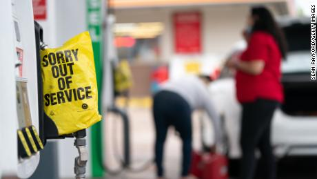 An out of service bag covers a pump handle at a gas station on May 12 in Fayetteville, North Carolina, caused by the shutdown of the Colonial Pipeline due to a cyber attack. While that shutdown is over, experts worry that a shortage of tank truck drivers could bring about a repeat of gas shortages this summer.