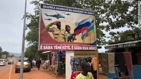 """Posters across Bangui are reminiscent of old Soviet propaganda. The posters read: """"Central African Republic is hand in hand with Russia"""" and """"talk a little, work a lot."""""""