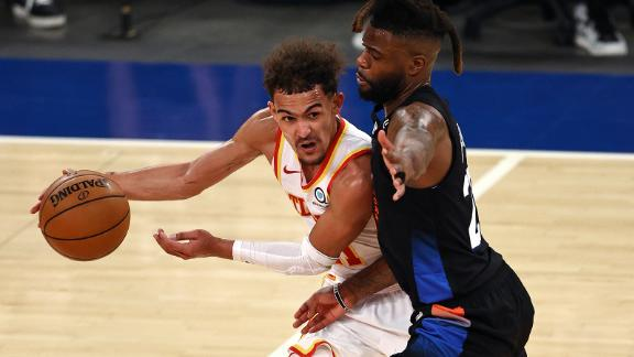 Atlanta Hawks' Trae Young, left, tries to get past New York Knicks' Reggie Bullock during the fourth quarter in Game 2 of the NBA playoffs.