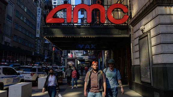 People walk past an AMC and IMAX movie theatre in the theatre district near Broadway on May 6, 2021 in New York City. - New York Governor Andrew Cuomo announced that Broadway will reopen on September 14, 2021  at one hundred percent capacity, with some tickets going on sale starting today. (Photo by Angela Weiss / AFP) (Photo by ANGELA WEISS/AFP via Getty Images)