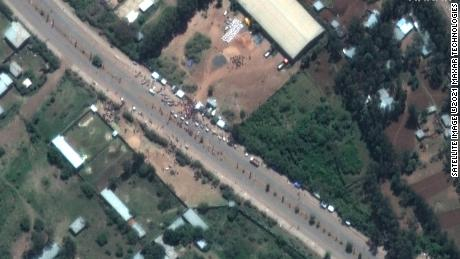 A crowd is seen outside the Guna distribution center on the outskirts of Shire, Ethiopia, in this satellite image captured on May 27. Detainees say they were beaten and tortured at the facility.
