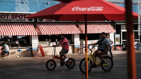 People ride along a boardwalk on the Jersey shores on May 27, 2021 in Wildwood, New Jersey.