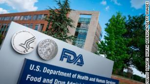 FDA says it's working as fast as possible to fully approve vaccines, as urgency rises amid Covid surge