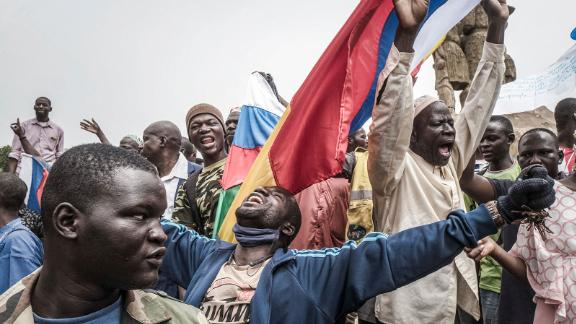 Russian and Malian flags are waved by protesters in Bamako, during a demonstration against French influence in the country on May 27.