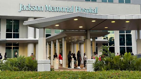 Some of the shooting victims' loved ones wait outside the Ryder Trauma Center at Jackson Memorial Hospital in Miami on Sunday.