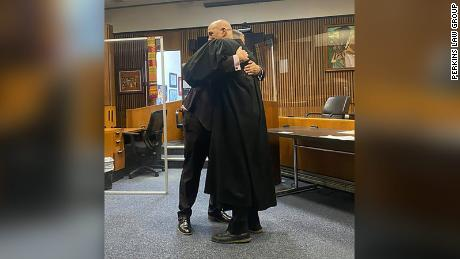 Edward Martell and Judge Bruce Morrow's hugging after Martell was sworn in.