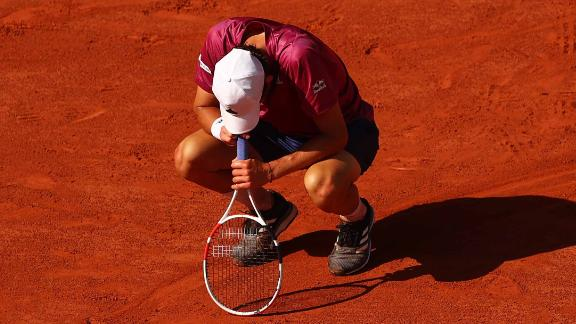 Dominic Thiem reacts during his shock first round defeat against Pablo Andújar at the 2021 French Open.