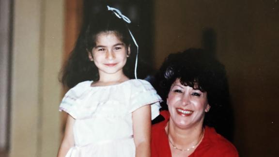 Jaclyn Greenberg and her mother, Linda, smile after Jaclyn's kindergarten graduation.