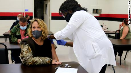 Nurse Joyce Barlow, right, gives the Covid-19 vaccine to a resident in Cuthbert, Georgia, at a vaccine clinic organized by local volunteers.