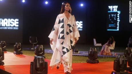 British model Naomi Campbell displays an outfit by Designer TZAR STUDIOS during the ARISE Fashion Week event in Lagos, Nigeria early Sunday , Dec. 13, 2020. (AP Photo/Sunday Alamba)