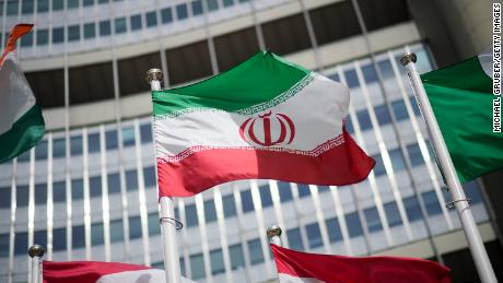 The Iranian flag is seen in front of the headquarters building of the International Atomic Energy Agency (IAEA) on May 24, 2021 in Vienna, Austria.