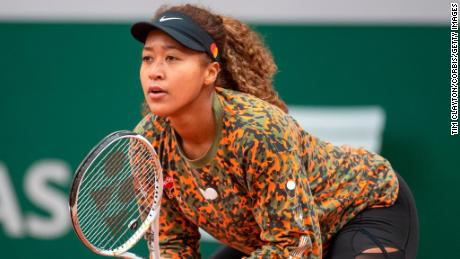 Naomi Osaka preparing for the French Open  during a practice match against Ashleigh Barty of Australia.