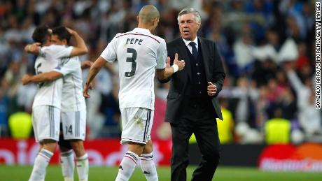 Pepe celebrates victory with Ancelotti after the UEFA Champions League quarter-final second leg match against Atletico Madrid.