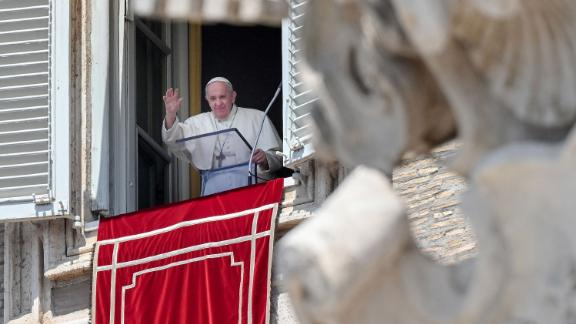 Pope Francis waves from a window of the apostolic palace overlooking St. Peter's Square in the Vatican on May 09, 2021.