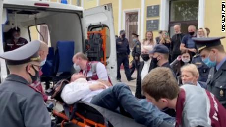 A still image taken from video footage shows Latypov being carried out of a court building in Minsk.