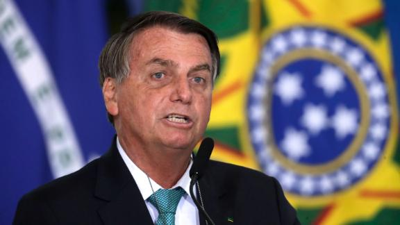 Brazil's President Jair Bolsonaro confirms his country to host the 2021 Copa America soccer tournament, during a ceremony of the state bank sponsoring Brazilian athletics, at the Planalto presidential palace, in Brasilia, Brazil, Tuesday, June 1, 2021. (AP Photo/Eraldo Peres)