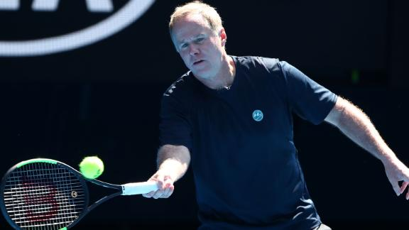 MELBOURNE, AUSTRALIA - JANUARY 21:  Patrick McEnroe of the United States plays a forehand in his Men's Legends match with and John McEnroe of the United States against Henri Leconte of France and Todd Woodbridge of Australia during day eight of the 2019 Australian Open at Melbourne Park on January 21, 2019 in Melbourne, Australia.  (Photo by Scott Barbour/Getty Images)