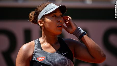 Osaka looks to her team during her match against Patricia Maria Țig at Roland Garros.