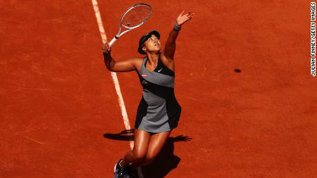 Osaka serves against Patricia Maria Tig at the 2021 French Open.
