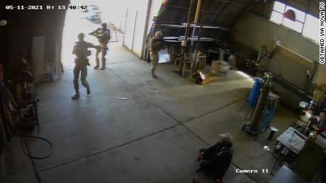 Video from the factory's security cameras obtained by CNN affiliate Nova TV appears to show US troops in military gear holding guns and walking in and out of the factory as others look on.