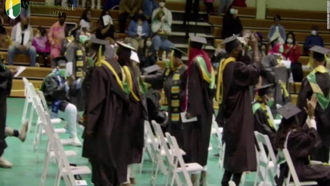 Grads celebrate as university president announces their debt forgiven - CNN Video