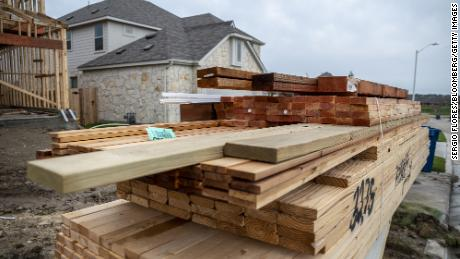 Piles of lumber outside a home under construction in the CastleRock Communities Sunfield residential development in Texas.