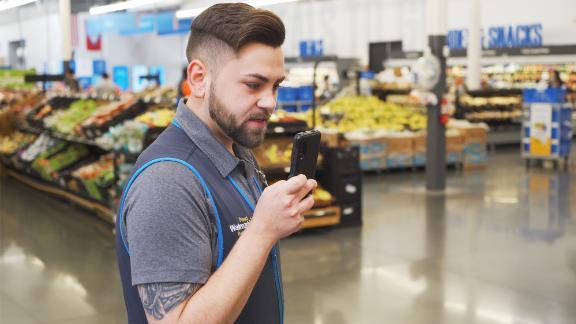 Walmart employee using the new phone.