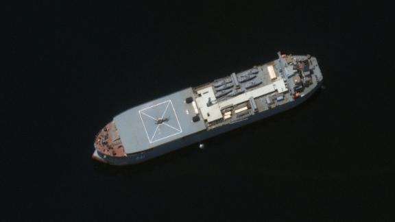 The Iranian ship Makran is seen in this Maxar Technologies satellite image from early May in the Persian Gulf around Larak Island. The vessel appears to be loaded with seven small fast-attack boats on its deck.