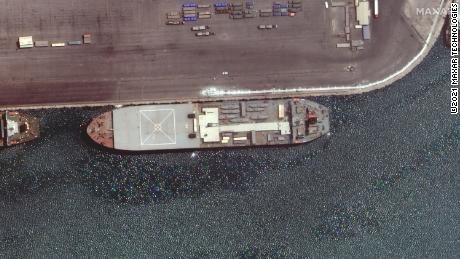 The Iranian ship Makran is seen in this Maxar Technologies satellite image from late April docked in the Iranian port of Bandar Abbas.  The boat appears to be loaded with seven small fast-attack boats on its deck.