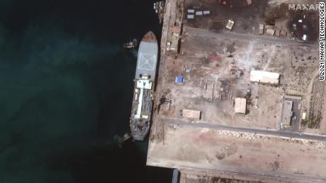 Iranian ship Makran can be seen in this Maxar Technologies satellite image taken in early May in the Persian Gulf around Larak Island.  The boat appears to be loaded with seven small, fast attack boats on its deck.