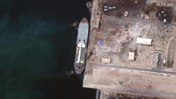 The Iranian ship Makran is seen in this Maxar Technologies satellite image from early May in Persian Gulf around Larak Island.  The boat appears to be loaded with seven small fast-attack boats on its deck.