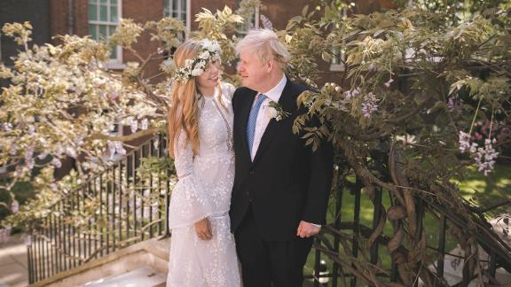 """British Prime Minister Boris Johnson is seen with his wife, Carrie, after <a href=""""https://www.cnn.com/2021/05/29/world/boris-johnson-marries-carrie-symonds-intl/index.html"""" target=""""_blank"""">their wedding</a> at London's Westminster Cathedral in May, 2021. The ceremony, described by PA Media as a """"secret wedding,"""" was reportedly held in front of close friends and family, according to several British newspaper accounts."""