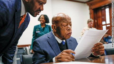 Congressman John Lewis read paperwork to qualify for reelection to his District 5 seat in Atlanta, Monday, March 2, 2020.