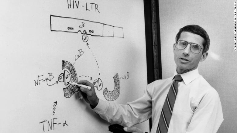 Dr. Anthony Fauci, director of the National Institute of Allergy and Infectious Diseases, talks to his team about HIV/AIDS during a meeting in 1990.