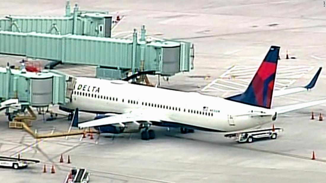 A passenger tried to breach the cockpit of a Delta flight, forcing the plane to make an emergency landing