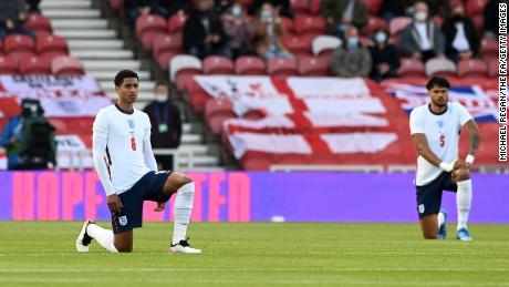 England players Jude Bellingham and Tyrone Mings of England take the knee ahead of the international friendly match against Austria at the Riverside Stadium on June 02, 2021 in Middlesbrough.