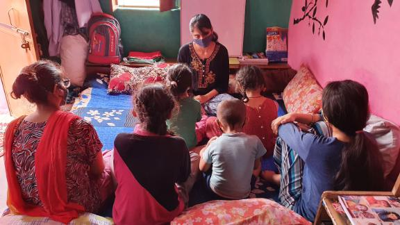 Devika teaches her younger siblings at home.