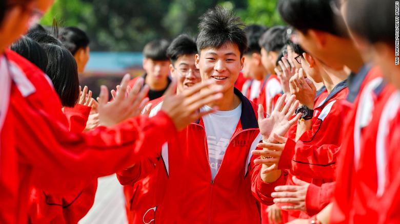 The big moment: Students in the Chinese city of Huzhou cheer before taking the national college entrance exam on Monday. Attended by millions of high school students each year, the two-day exam is considered the most important -- and most stressful -- test a Chinese student will take in their academic lifetime.