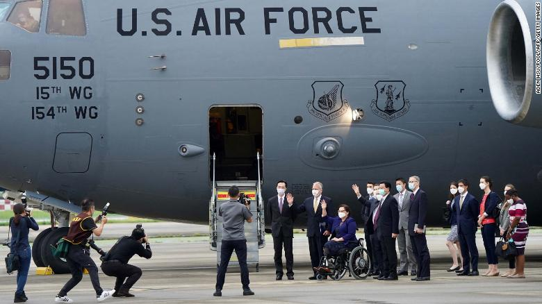 US senators are seen in front of the US Air Force C-17 Globemaster III freighter upon their arrival at Taipei's Songshan Airport on June 6.