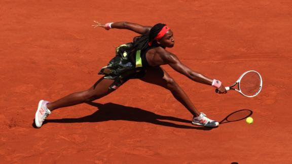 Gauff plays a backhand in her ladies singles fourth round match against Ons Jabeur.