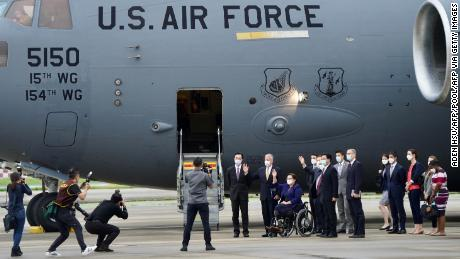US senators in front of the US Air Force C-17 Globemaster III freighter upon their arrival at Taipei's Songshan Airport on June 6.