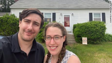 John Wright and Maura Quinn in front of the home they sold in a matter of days in Burlington, Vermont, before starting a home search in St. Louis.