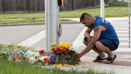 A man brings flowers and pays his respects at the scene in London, Ontario, on June 7, 2021.