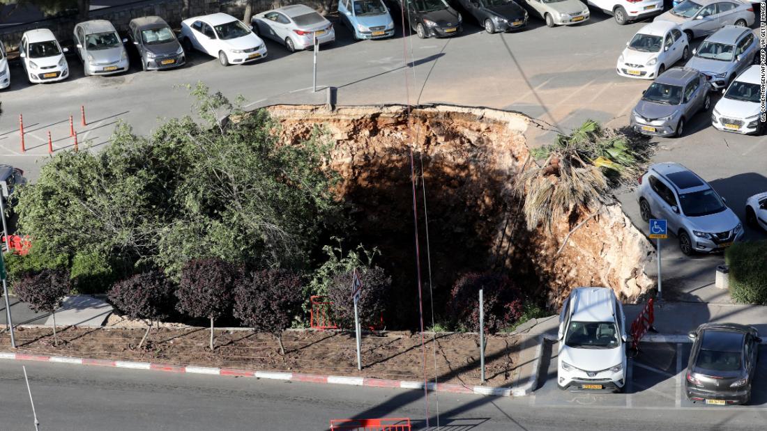 Watch sinkhole swallow up parked cars in Jerusalem